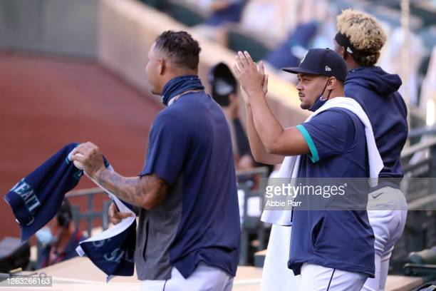 Justus Sheffield of the Seattle Mariners celebrates a defensive stop by J.P. Crawford in the third inning against the Oakland Athletics during their...