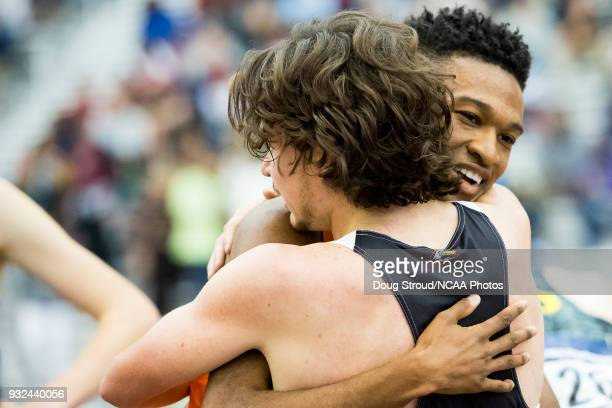 Justyn Knight of Syracuse University is embraced by Mike Tate of Southern Utah University after winning the Mens 5000 Meter Race during the Division...