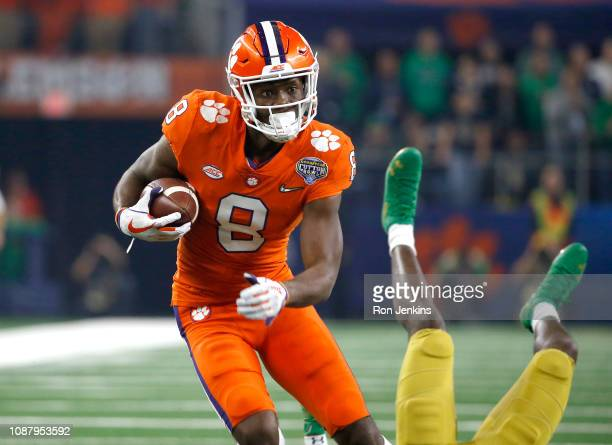 Justyn Ross of the Clemson Tigers catches a 52-yard touchdown pass in the second quarter against Jalen Elliott of the Notre Dame Fighting Irish...