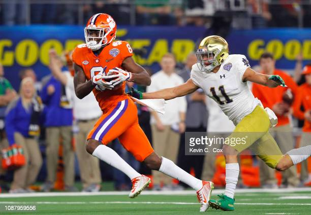 Justyn Ross of the Clemson Tigers catches a pass for a 42 yard touchdown catch in the second quarter against Alohi Gilman of the Notre Dame Fighting...