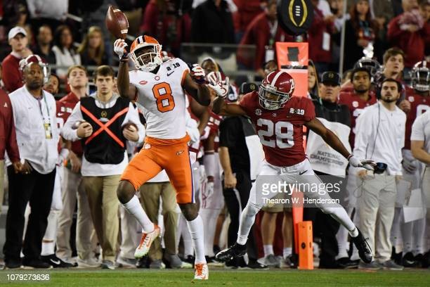 Justyn Ross of the Clemson Tigers makes a catch against Josh Jobe of the Alabama Crimson Tide during the third quarter in the CFP National...