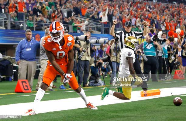 Justyn Ross of the Clemson Tigers reacts after catching a 52-yard touchdown pass in the second quarter against Jalen Elliott of the Notre Dame...