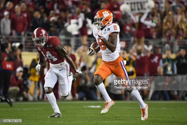 Justyn Ross of the Clemson Tigers scores a third quarter seventy four yard touchdown reception against the Alabama Crimson Tide in the CFP National...