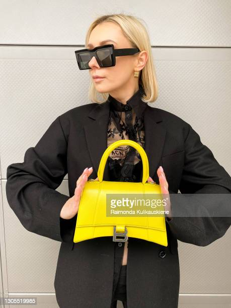 Justyna Czerniak cherishing Paris Fashion Designers for Paris fashion week by wearing Acne Studios black semitransparent shirt, black blazer and...