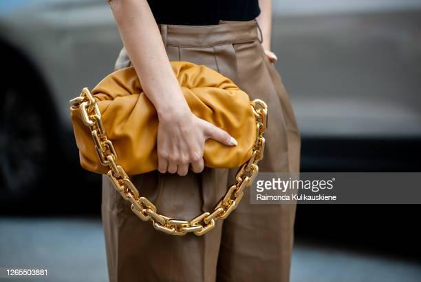 Justyna Czerniak outside Malaikaraiss wearing brown leather shorts and black top and Bottega Veneta bag during Copenhagen fashion week SS21 on August...