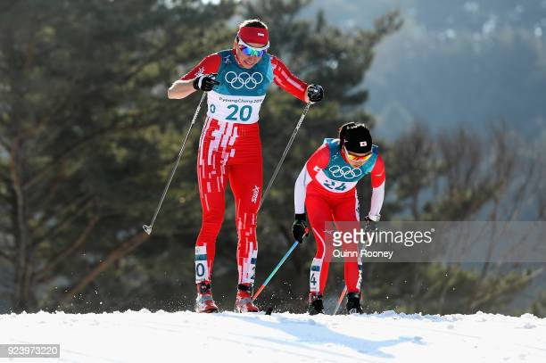 Justyna Kowalczyk of Poland and Masako Ishida of Japan compete during the Ladies' 30km Mass Start Classic on day sixteen of the PyeongChang 2018...