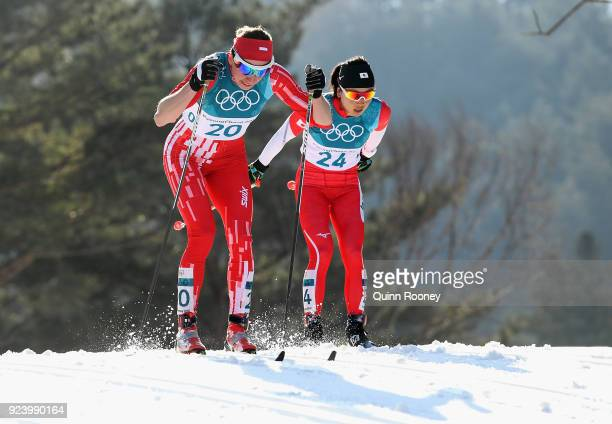 Justyna Kowalczyk of Poland and Masako Ishida of Japan competes during the Ladies' 30km Mass Start Classic on day sixteen of the PyeongChang 2018...