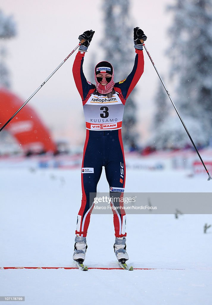 Justyna Kowalczyk of Poland celebrates after the women 10km free handicap start during the FIS World Cup Cross Country Skiing on November 28, 2010, in Kuusamo, Finland.