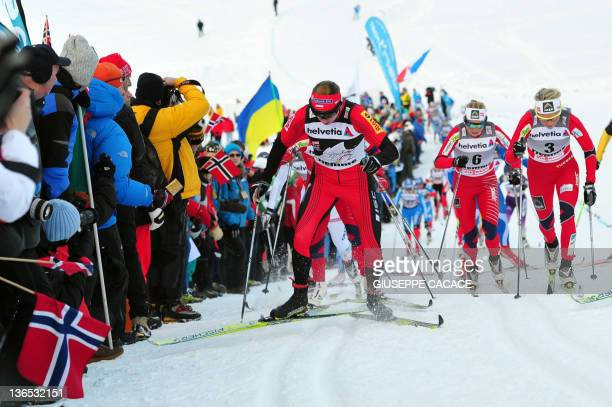 Justyna Kowalczyk of Poland competes next to Marthe Kristoffersen and Therese Johaug of Norway during the women's 10 km Classic mass start race 8 of...