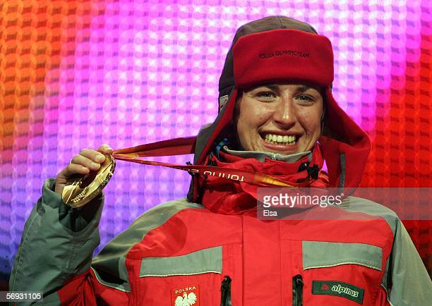 Justyna Kowalczyk of Poland holds her bronze medal in the Ladies' 30km crosscountry sking during the Medals Ceremony on Day 14 of the Turin 2006...