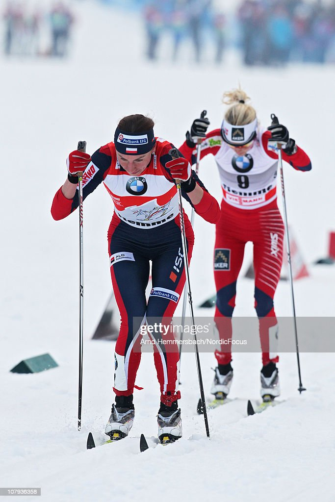 Justyna Kowalczyk of Poland leads Therese Johaug of Norway compete during the mass women for the FIS Cross Country World Cup Tour de Ski on January 8, 2011 in Val di Fiemme, Italy.