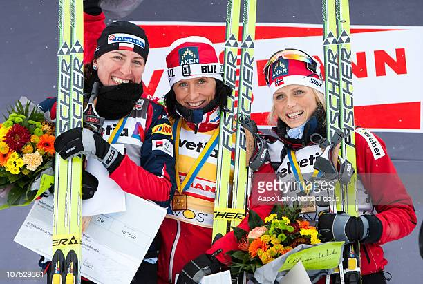 Justyna Kowalczyk of Poland Marit Bjorgen of Norway and Therese Johaug of Norway pose on the podium after the Women's 10 km Individual event in the...