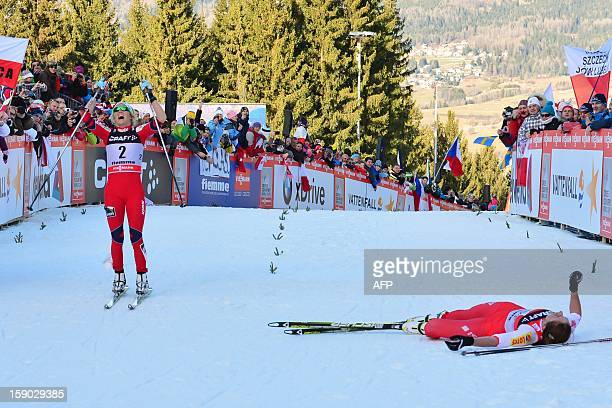 Justyna Kowalczyk of Poland reacts after crossing the finish line ahead Therese Johaug of Norway during the women's 9km free final climb pursuit of...