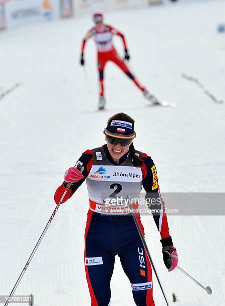 Justyna Kowalczyk of Poland skis to 2nd place ahead of Kristin Stoermer Steira of Norway taking 3rd place during the FIS CrossCountry World Cup...