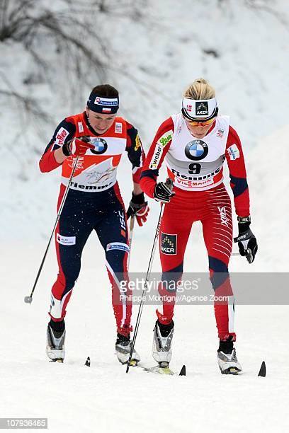 Justyna Kowalczyk of Poland takes 1st place Therese Johaug of Norway takes 2nd place during the FIS CrossCountry World Cup Tour de Ski Women's 10 km...