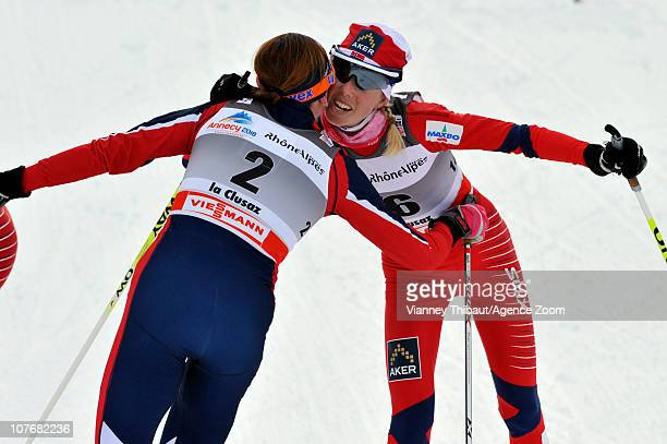 Justyna Kowalczyk of Poland takes 2nd place Kristin Stoermer Steira of Norway takes 3rd place during the FIS CrossCountry World Cup Women's 15 km...