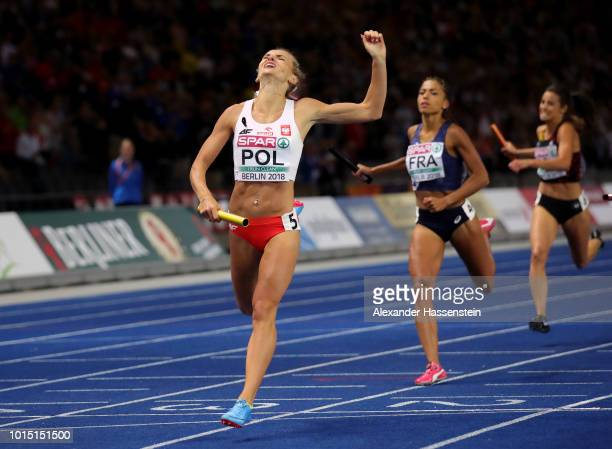 Justyna SwietyErsetic of Poland crosses the finish line to win Gold in the Women's 4 x 400m Relay Final during day five of the 24th European...
