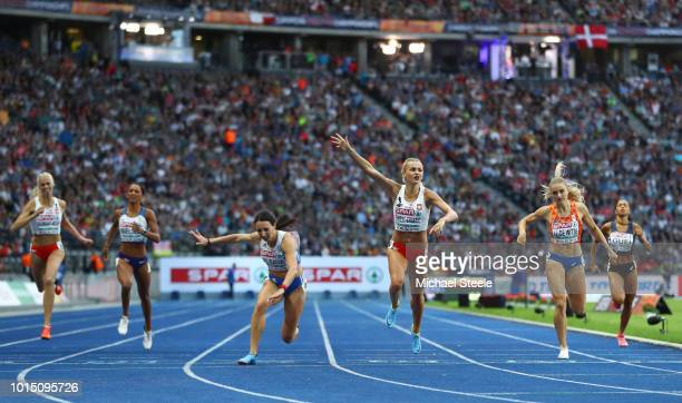 Justyna SwietyErsetic of Poland crosses the line to win gold ahead of Maria Belibasaki of Greece in the Women's 400 metres final during day five of...