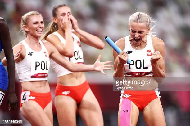 Justyna Swiety-Ersetic of Team Poland celebrates with teammates after winning the silver medal in the Women' s 4 x 400m Relay Final on day fifteen of...