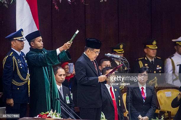 Jusuf Kalla is sworn as Vice President during an inauguration ceremony at the House of Representative building on October 20, 2014 in Jakarta,...