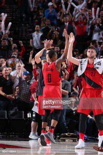 Jusuf Nurkic and Damian Lillard of the Portland Trail Blazers give high fives during the game against the Cleveland Cavaliers on March 15 2018 at the...