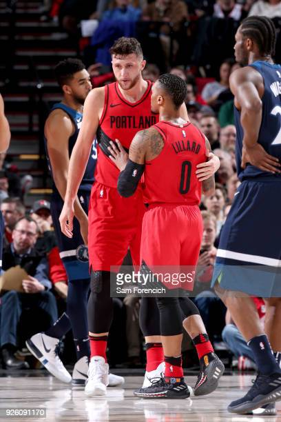 Jusuf Nurkic and Damian Lillard of the Portland Trail Blazers talk during the game against the Minnesota Timberwolves on March 1 2018 at the Moda...