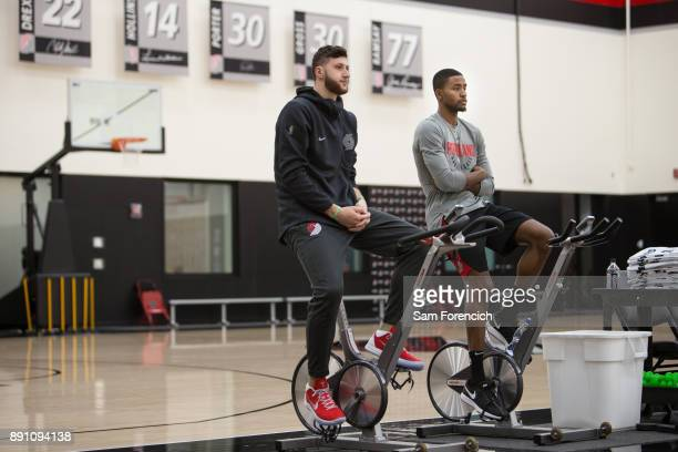 Jusuf Nurkic and Maurice Harkless of the Portland Trail Blazers work out on the bike during an all access practice on December 7 2017 at the Trail...