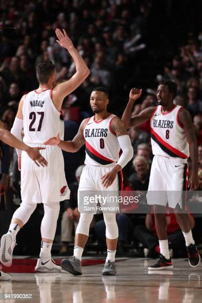 Jusuf Nurkic Damian Lillard and AlFarouq Aminu of the Portland Trail Blazers exchange high fives during the game against the Memphis Grizzlies on...