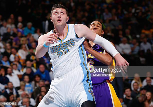 Jusuf Nurkic of the Denver Nuggets and Jordan Clarkson of the Los Angeles Lakers battle for rebounding position at Pepsi Center on April 8 2015 in...