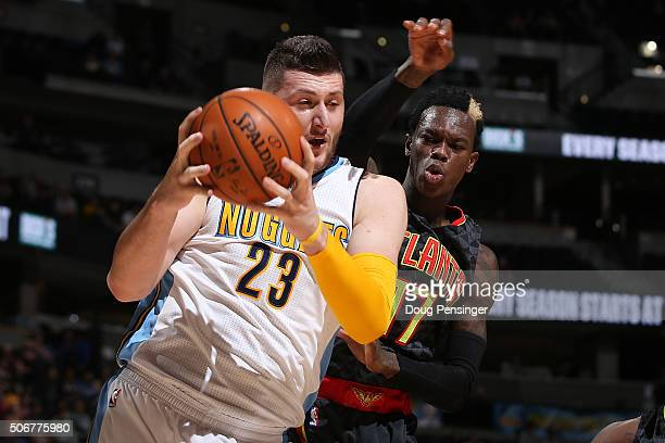 Jusuf Nurkic of the Denver Nuggets collects a rebound against Dennis Schroder of the Atlanta Hawks at Pepsi Center on January 25 2016 in Denver...