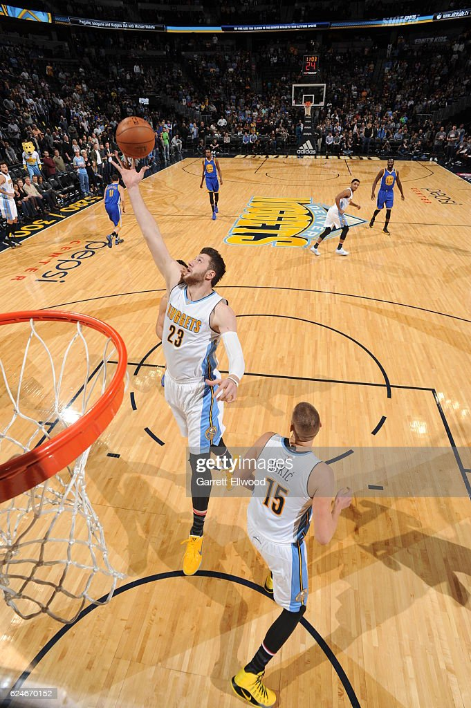 Jusuf Nurkic #23 of the Denver Nuggets goes for the rebound during the game against the Golden State Warriors on November 10, 2016 at the Pepsi Center in Denver, Colorado.