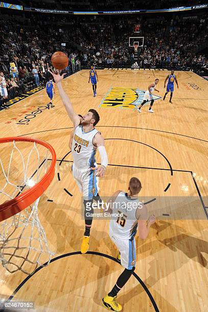 Jusuf Nurkic of the Denver Nuggets goes for the rebound during the game against the Golden State Warriors on November 10 2016 at the Pepsi Center in...