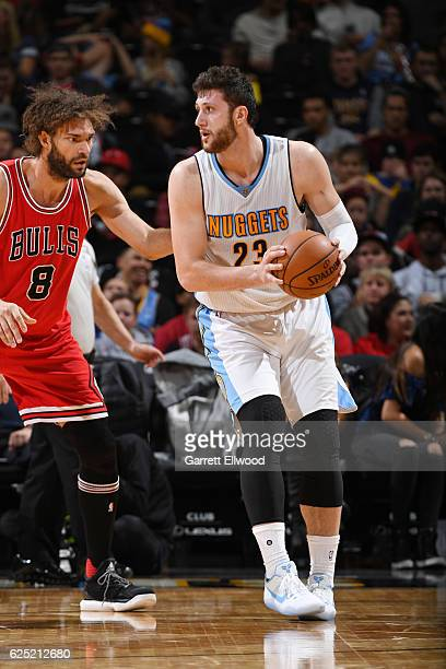 Jusuf Nurkic of the Denver Nuggets handles the ball against Robin Lopez of the Chicago Bulls during the game on November 22 2016 at the Pepsi Center...