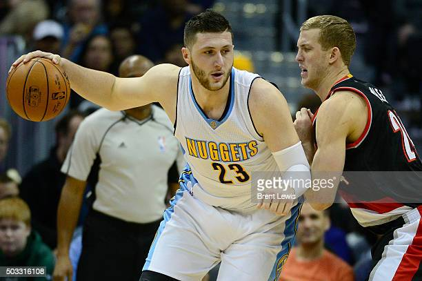 Jusuf Nurkic of the Denver Nuggets tries to back down Mason Plumlee of the Portland Trail Blazers during the second half at the Pepsi Center on...
