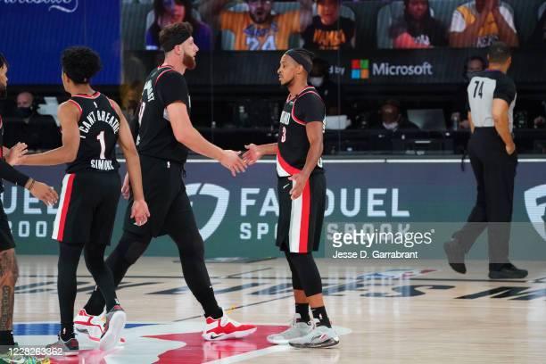 Jusuf Nurkic of the Portland Trail Blazers and Damian Lillard of the Portland Trail Blazers highfive during a game against the Los Angeles Lakers...