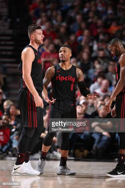 Jusuf Nurkic of the Portland Trail Blazers and Damian Lillard of the Portland Trail Blazers look on during the game against the Golden State Warriors...