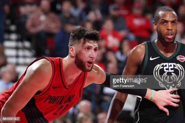Jusuf Nurkic of the Portland Trail Blazers and Khris Middleton of the Milwaukee Bucks await the ball during the game on November 30 2017 at the Moda...