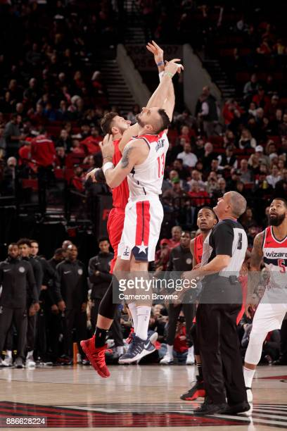 Jusuf Nurkic of the Portland Trail Blazers and Marcin Gortat of the Washington Wizards tip off at the beginning of the first quarter on December 5...