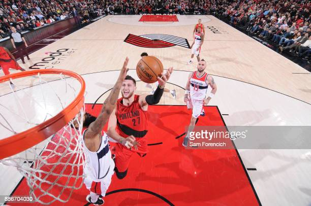Jusuf Nurkic of the Portland Trail Blazers drives to the basket against the Washington Wizards on December 5 2017 at the Moda Center in Portland...