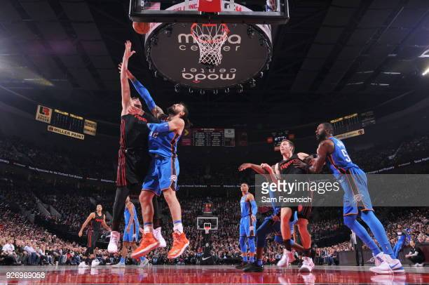 Jusuf Nurkic of the Portland Trail Blazers dunks against Steven Adams of the Oklahoma City Thunder on March 3 2018 at the Moda Center in Portland...