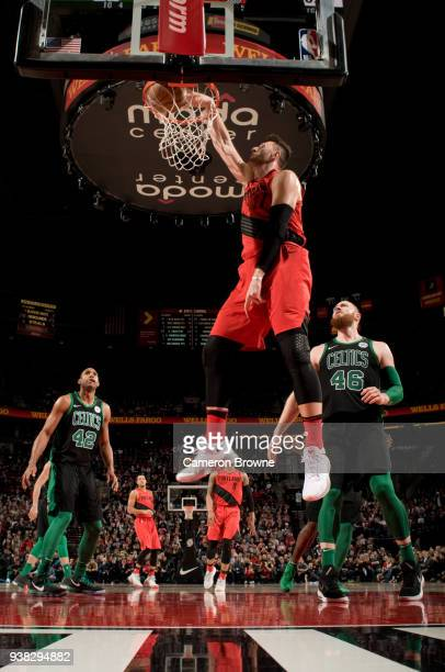 Jusuf Nurkic of the Portland Trail Blazers dunks the ball against the Boston Celtics on March 23 2018 at the Moda Center Arena in Portland Oregon...