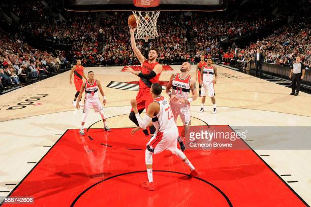 Jusuf Nurkic of the Portland Trail Blazers goes for a layup against the Washington Wizards on December 5 2017 at the Moda Center in Portland Oregon...