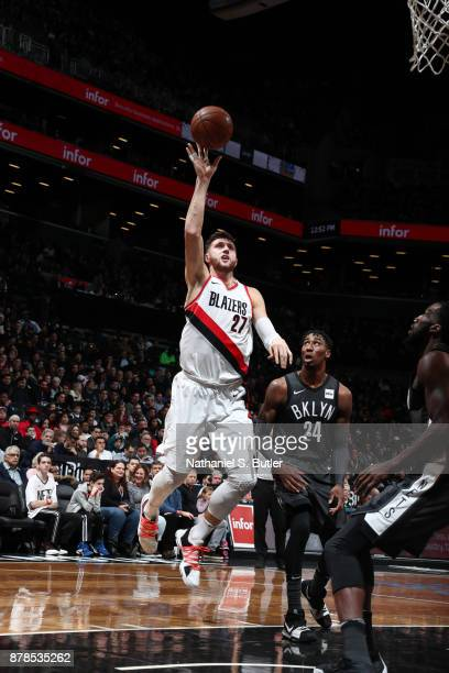 Jusuf Nurkic of the Portland Trail Blazers goes to the basket against Rondae HollisJefferson of the Brooklyn Nets on November 24 2017 at Barclays...