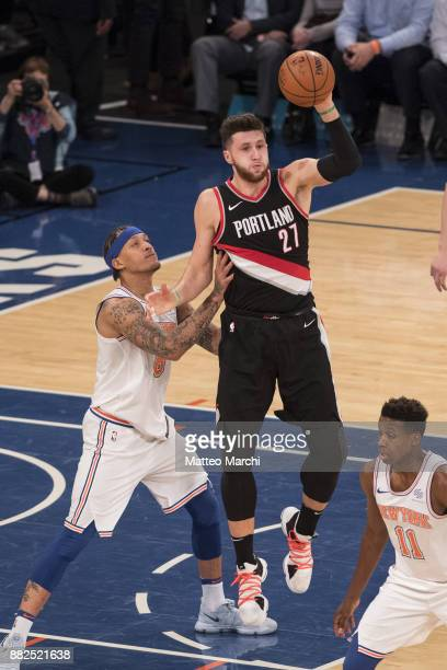 Jusuf Nurkic of the Portland Trail Blazers handles the ball against Michael Beasley of the New York Knicks during the first half of the NBA game at...