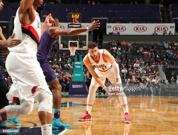 Jusuf Nurkic of the Portland Trail Blazers handles the ball against the Charlotte Hornets on December 16 2017 at Spectrum Center in Charlotte North...