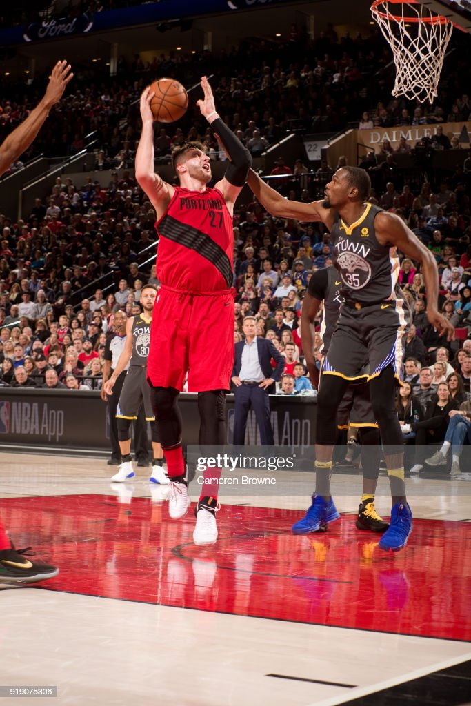 Jusuf Nurkic #27 of the Portland Trail Blazers handles the ball against the Golden State Warriors on February 14, 2018 at the Moda Center Arena in Portland, Oregon.