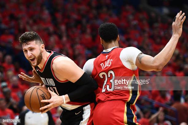 Jusuf Nurkic of the Portland Trail Blazers is defended by Anthony Davis of the New Orleans Pelicans during the first half of Game Four of the first...