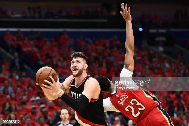 Jusuf Nurkic of the Portland Trail Blazers is defended by Anthony Davis of the New Orleans Pelicans during Game Four of the first round of the...