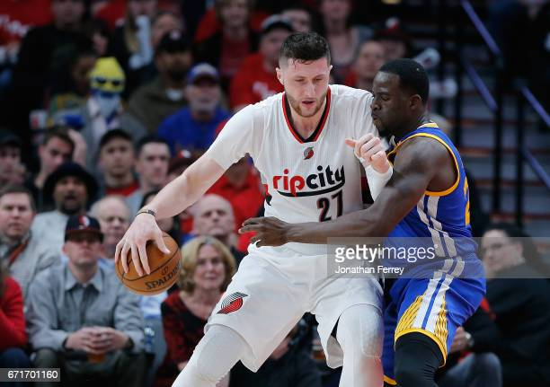 Jusuf Nurkic of the Portland Trail Blazers is guarded by Draymond Green of the Golden State Warriors during Game Three of the Western Conference...