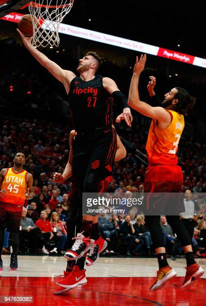 Jusuf Nurkic of the Portland Trail Blazers lays up the ball against Ricky Rubio of the Utah Jazz at Moda Center on April 11 2018 in Portland...